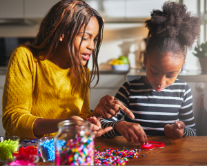 Mom Crafting With Daughter
